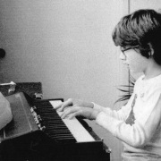 Claude Mottier playing on keyboard. Fort Lauderdale, FL, 1979