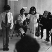 Claude Mottier bowing after concert at summer camp. Merrywood, Lenox MA, 1984