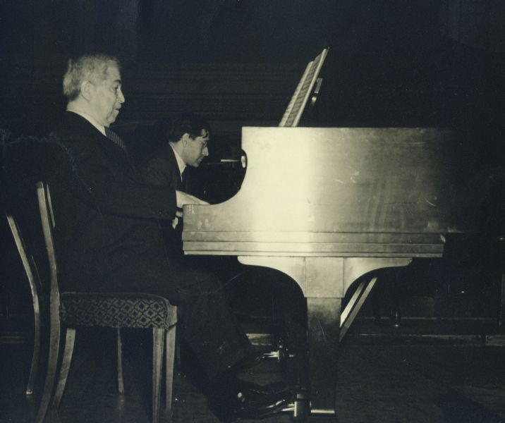 Artur Schnabel and son Karl Ulrich Schnabel at rehearsal of Bach, Concerto for 2 pianos and orchestra, C major, at Carnegie Hall, New York, February 1947. In background conductor Charles