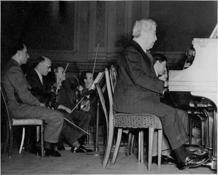 Artur Schnabel and son Karl Ulrich Schnabel at rehearsal of Bach, Concerto for 2 pianos and orchestra, C major, at Carnegie Hall, New York, February 1947. In background conductor Charles Adler.