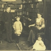 Artur, Karl Ulrich (standing), Therese, and Stefan (sitting) in library in Berlin (about 1913)