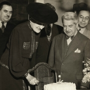 Therese and Artur Schnabel cutting birthday cake. 1940's