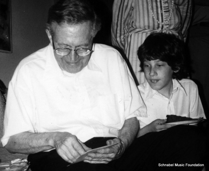 Karl Ulrich Schnabel opening gifts on his birthday, with his grandson Claude, West Hartford, 1984
